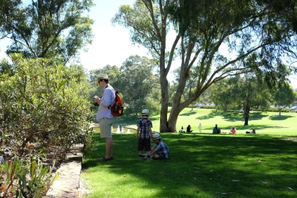Inspecting botanical wonders with the Pioneer Women's Memorial in the background.